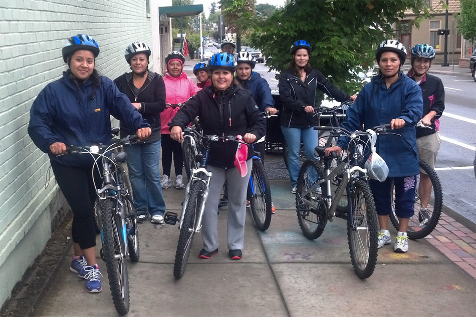 A group of ten pose with their bikes in central Hillsboro.